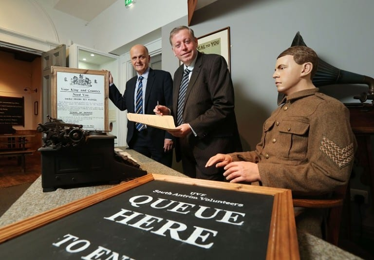 Alderman Paul Porter, Chairman of the Council's Leisure Services Committee and Mr Jim Rose, Director of Leisure Services visit the 'Recruitment Desk' to launch the 'Lisburn 1912-1914' exhibition at the Irish Linen Centre and Lisburn Museum.