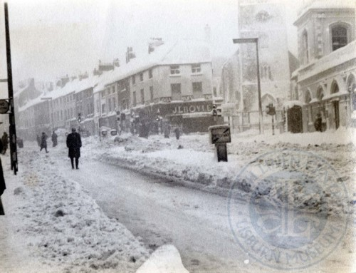 Lisburn Advent Calendar 2016 – Day 23: Market Square North in the snow, c.1963