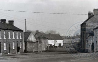 Quay Street with the Island chimney, as seen from Bridge Street, c.1960s