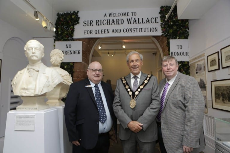 Museum Service manager Paul Allison (left) showing Mayor of Lisburn & Castlereagh, Councillor Uel Mackin, and Alderman Paul Porter (right), Chairman of Leisure & Community Development Committee, around the museum's new Sir Richard Wallace exhibition.