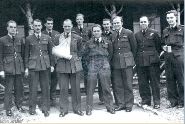 Alfie Martin (back row, centre) with colleagues from 102 Squadron in April 1943. In this photograph Martin is wearing the lapel badges of the Voluntary Reserve, or VR.