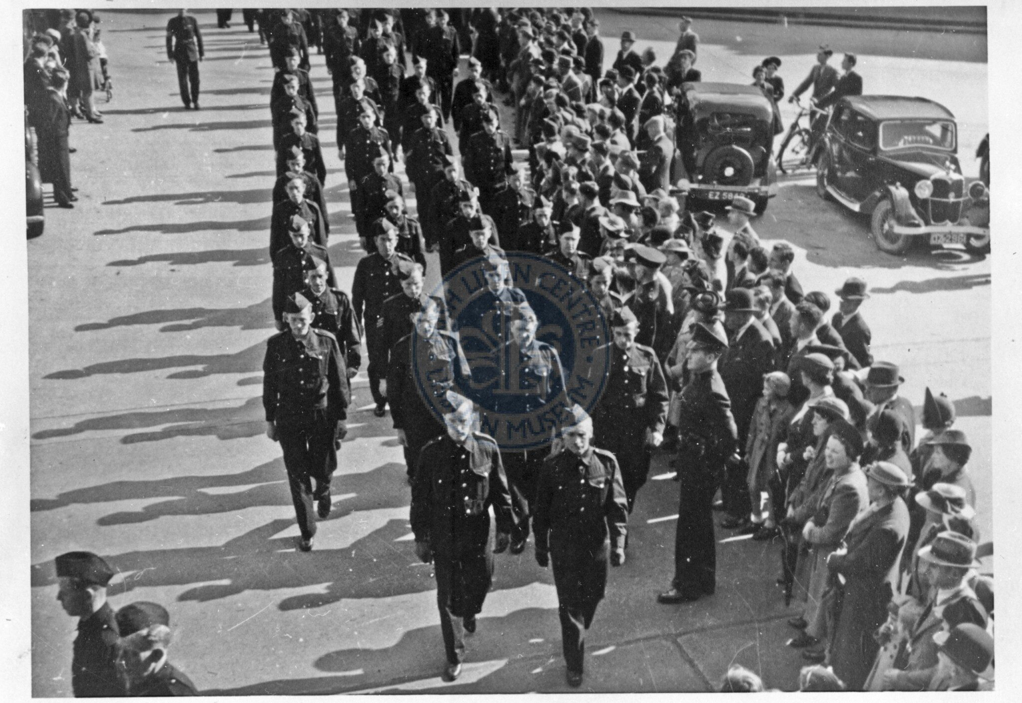A Local Defence Volunteers unit parading through Market Square in 1940.