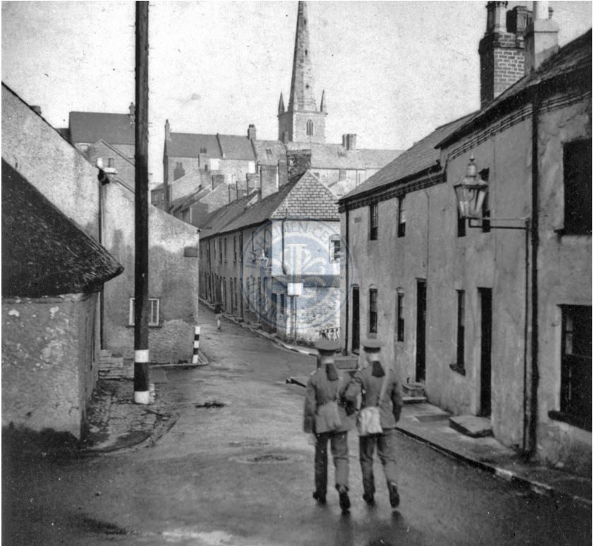 A rare photograph of war time Lisburn with two Royal Welch Fusiliers walking up Piper's Hill towards Market Square in late 1939.