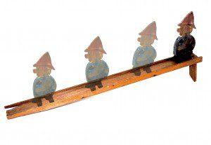 Wooden ramp walker toy in motion