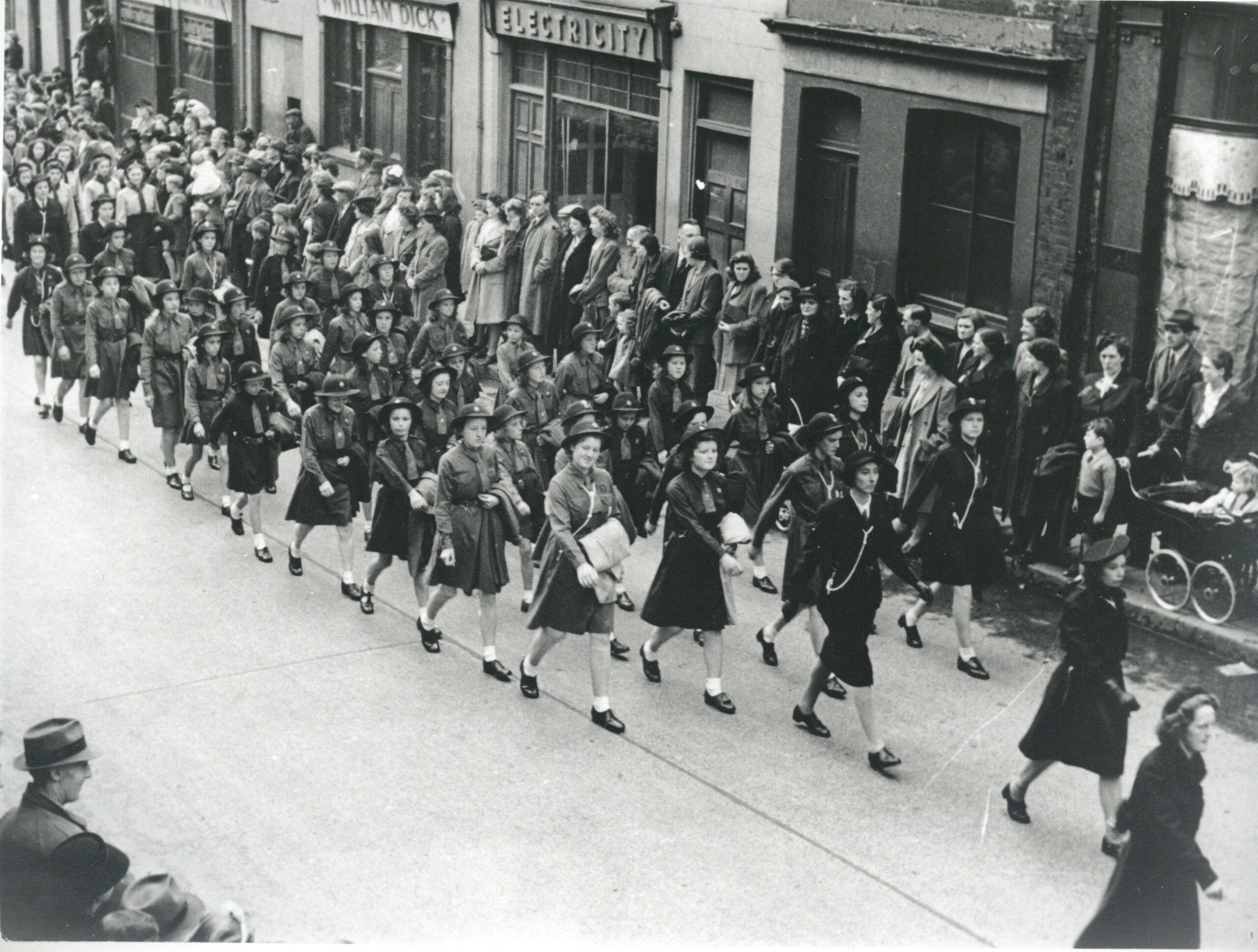 Hillhall Girl Guides parading in Castle St on V.E. Day